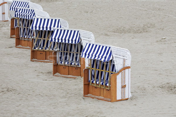 Roofed beach chairs placed in a line Stock photo © marekusz