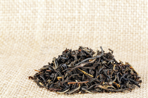 Fekete aszalt tea levelek durva vászon Stock fotó © marekusz