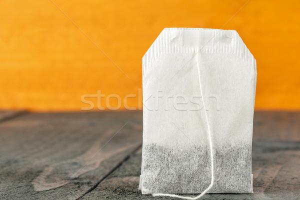 Tea bag shown on wooden background Stock photo © marekusz