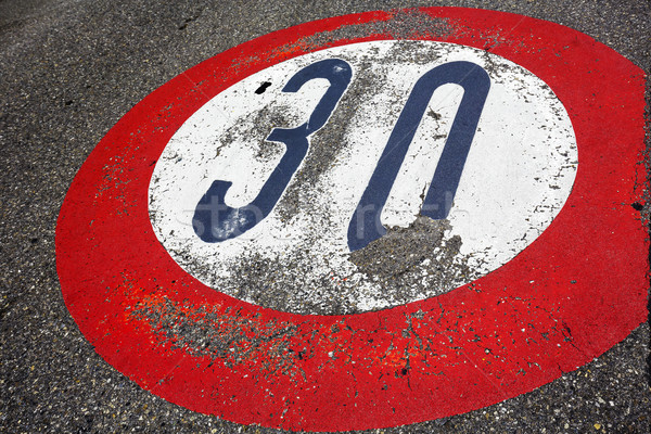 Road sign speed limit of thirty per hour  Stock photo © marekusz
