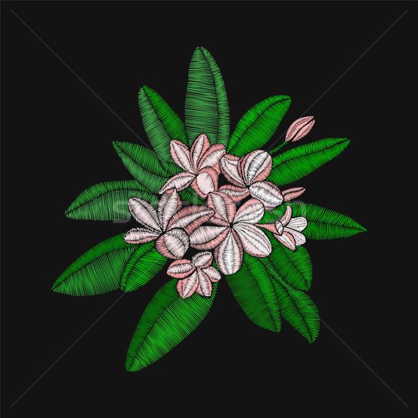 flowers embroidery Frangipani and leaves, Plumeria on black back Stock photo © Margolana