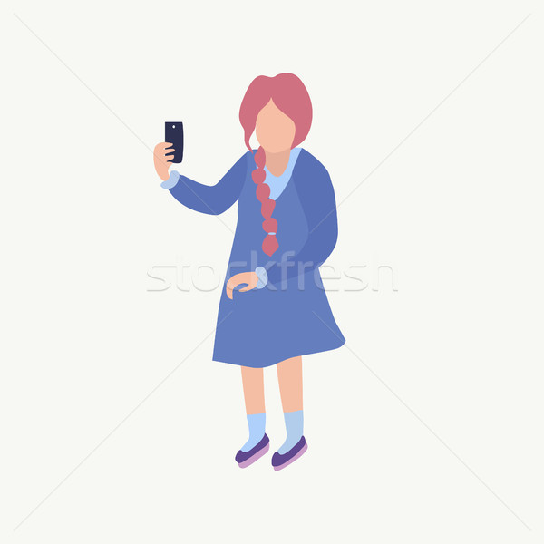 A girl makes selfie Cute young girl with smartphone taking a pic Stock photo © Margolana