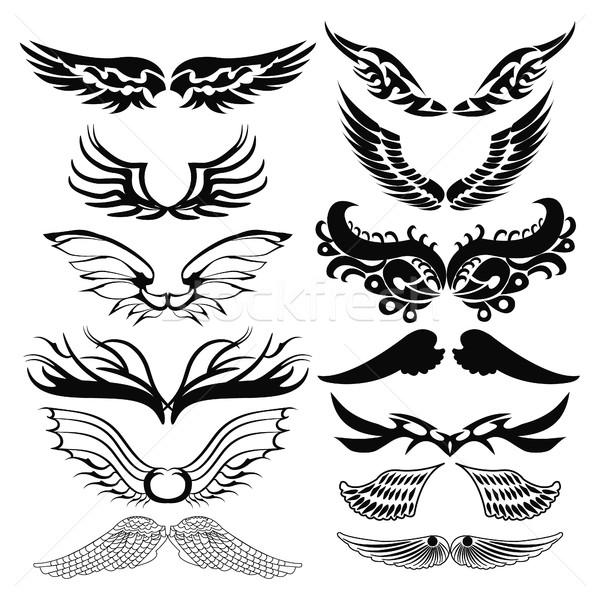 Plemiennych tatuaż zestaw skrzydełka czarny biały Zdjęcia stock © Margolana