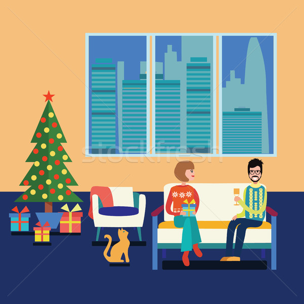 Couple at home sitting on sofa in the christmas room. Stock photo © Margolana