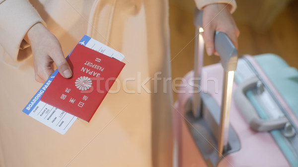 Girl holds Japan passport and boarding pass Stock photo © Margolana