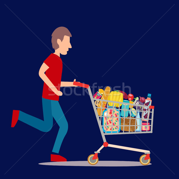 Shopping cart full of groceries products. Stock photo © Margolana