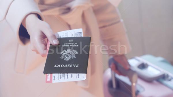 Girl holds USA passport and boarding pass Stock photo © Margolana