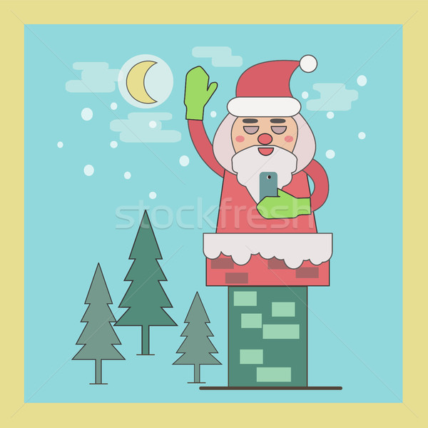 Stock photo: Santa Claus in Chimney holding smart phone