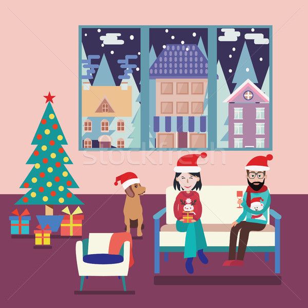 Couple At Home Sitting On Sofa In The Christmas Living Room