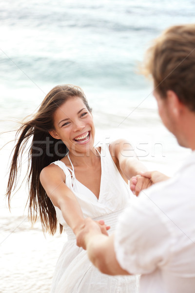 Beach summer vacation fun with playful couple Stock photo © Maridav