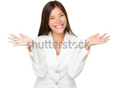 Cheerful Young Businesswoman Shrugging Stock photo © Maridav