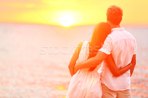 Stock photo: Honeymoon couple romantic in love at beach sunset