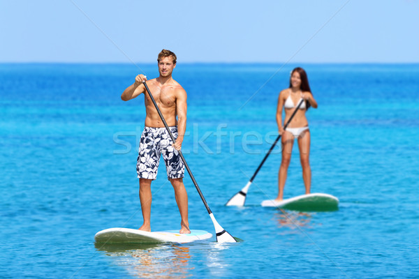 Foto stock: Playa · personas · stand · hasta · bordo · tabla · de · surf