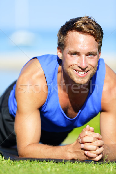 Fitness man training plank core exercise Stock photo © Maridav