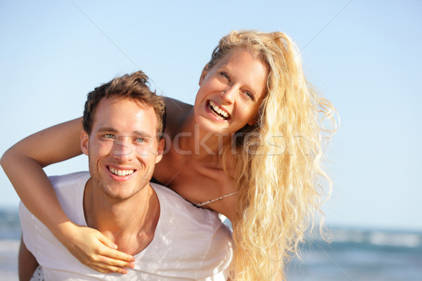 Beach couple fun - lovers on romantic travel Stock photo © Maridav