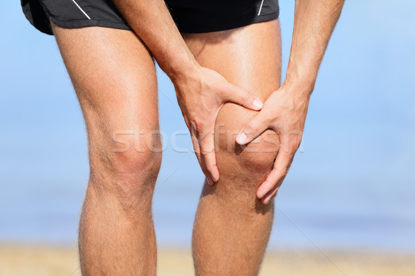Runner injury - Man running with knee pain Stock photo © Maridav