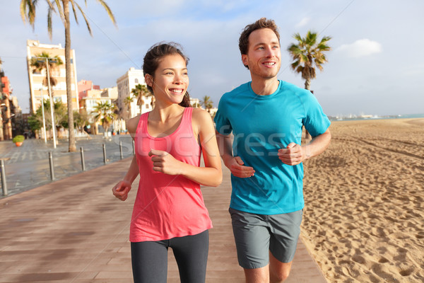 Running couple jogging Barcelona Beach Barceloneta Stock photo © Maridav