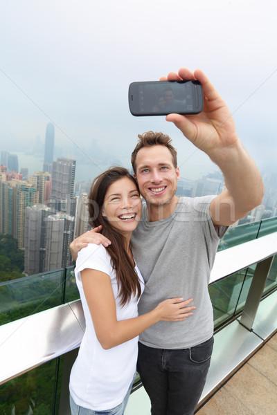 Hong Kong Victoria Peak tourists couple selfie Stock photo © Maridav