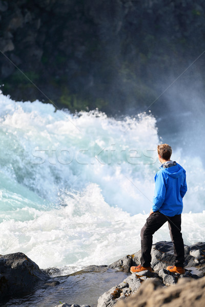Iceland tourist by river after waterfall Godafoss Stock photo © Maridav