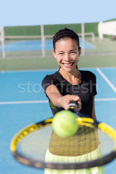 Tennis girl showing racquet and ball on court Stock photo © Maridav