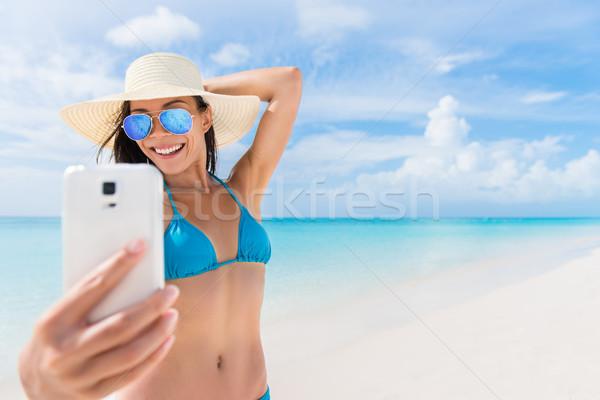 Summer beach vacation girl taking fun phone selfie Stock photo © Maridav