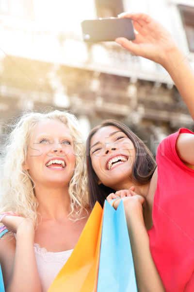 Girlfriends shopping laughing happy taking photo Stock photo © Maridav