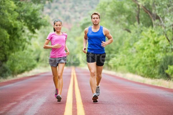 Fitness sport couple running jogging Stock photo © Maridav