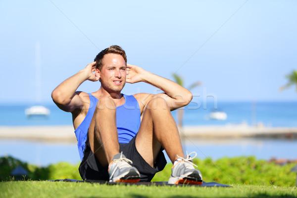 Man exercising sit-ups outside Stock photo © Maridav