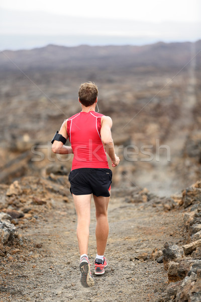 Trail runner man running cross-country run Stock photo © Maridav