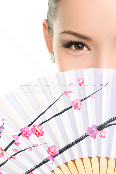 Asian chinese woman looking seductive with paper fan Stock photo © Maridav