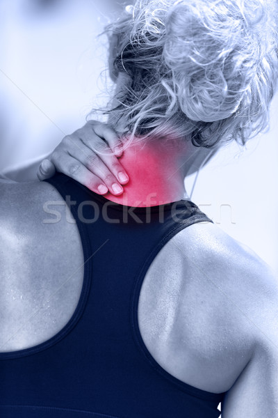 Hurting neck - female runner showing pain with red Stock photo © Maridav
