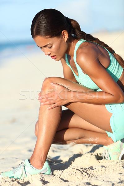 Runner leg injury - Asian running woman with hurting knee pain Stock photo © Maridav