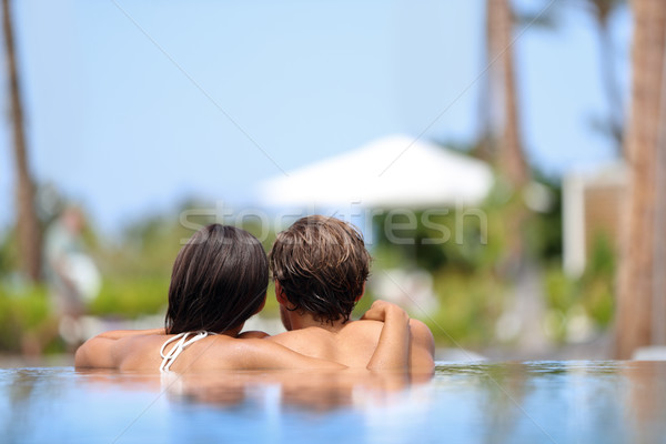 Honeymoon couple relaxing together - swimming pool Stock photo © Maridav