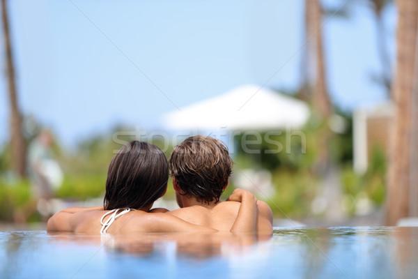 Nászút pár megnyugtató együtt úszómedence végtelen Stock fotó © Maridav
