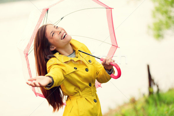 Fall woman happy after rain walking umbrella Stock photo © Maridav