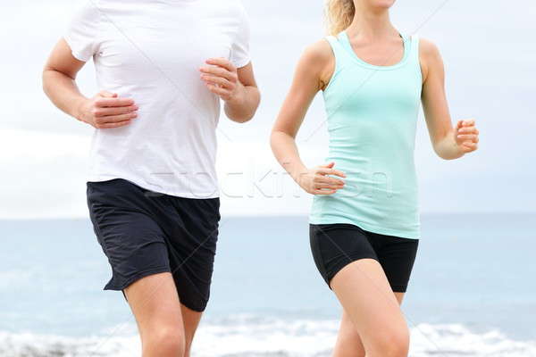 Runners - people running on beach midsection Stock photo © Maridav