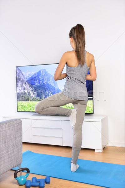 Yoga video woman training in home living room Stock photo © Maridav