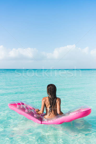 Beach vacation woman relaxing on an ocean mattress Stock photo © Maridav