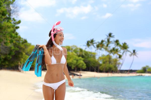 Snorkeling woman on tropical beach holiday travel Stock photo © Maridav