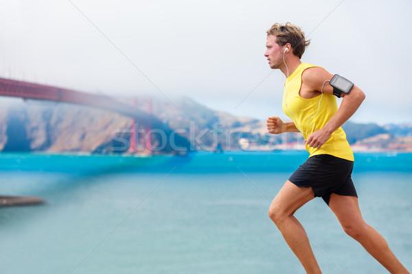 Runner man listening to music run in San Francisco Stock photo © Maridav