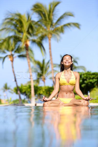 Serene meditating woman relaxing at luxury travel Stock photo © Maridav