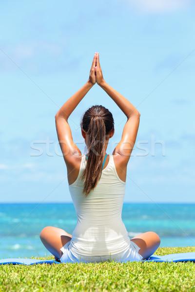 Meditation yoga woman meditating at beach Stock photo © Maridav