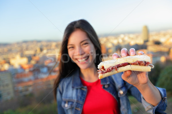 Jamon Iberico Sandwich - woman eating in Barcelona Stock photo © Maridav