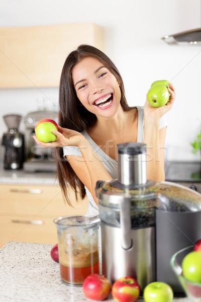 Apple juice on juicer machine at home in kitchen Stock photo © Maridav