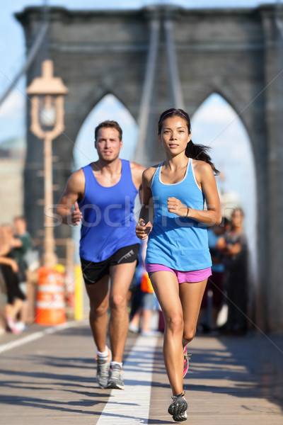 New York runners running on Brooklyn bridge NYC Stock photo © Maridav