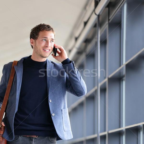 Smartphone businessman talking on smart phone Stock photo © Maridav