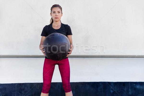 Fitness gym woman training arms with medicine ball Stock photo © Maridav