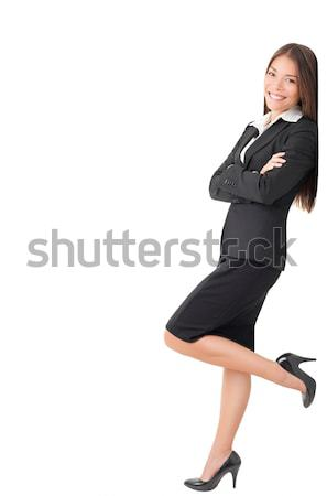 Businesswoman in suit leaning on wall Stock photo © Maridav