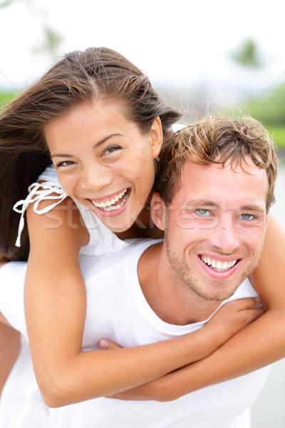 Couple happy having fun piggybacking Stock photo © Maridav