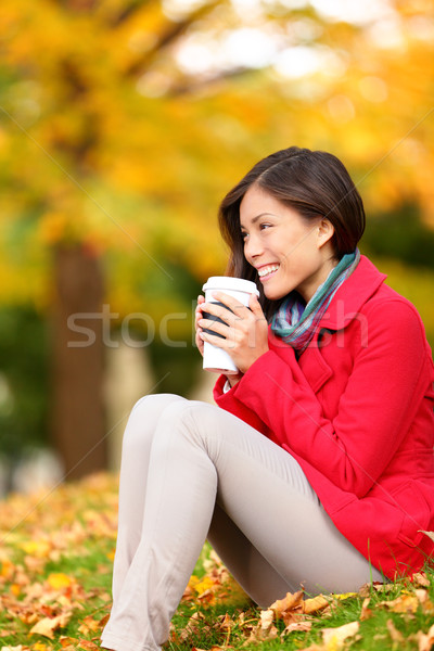 Autumn woman drinking coffee in fall forest Stock photo © Maridav
